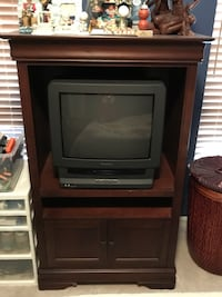 Black crt tv with brown wooden tv hutch Round Hill, 20141