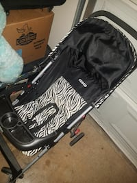 baby's black and gray Cosco stroller