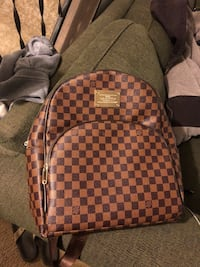 brown and black Louis Vuitton backpack Longmont, 80501