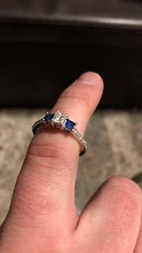 White gold engagement ring with 1/2 carat blue