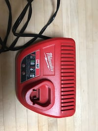 Milwaukee Battery M12 Charger. North Babylon