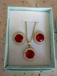women's gold-colored earrings and necklace with clear and red gemstones Sugar Land, 77498