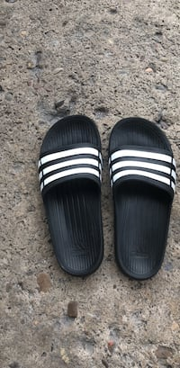 pair of black-and-white Adidas slide sandals Plymouth, 18651
