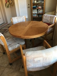 round brown wooden table with four chairs dining set Mesa, 85209