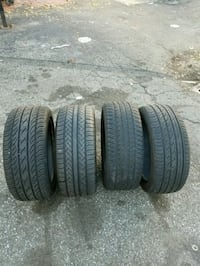 four black vehicle tire set Newark, 07105