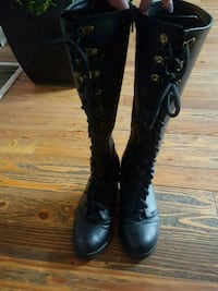 pair of black leather boots London, N5Z 1R4