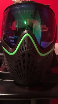 Black and green paintball mask