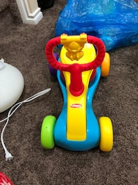 Blue and yellow fisher-price ride on toy Edmonton, T6T 0M3