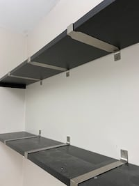 2 brown shelves w beautiful silver strapping. Approx 5ft in length Mississauga, L4W 2E5
