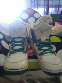pair of white Air Jordan Flight basketball shoes