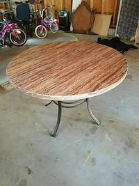 round brown wooden dining table 419 mi