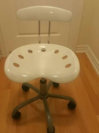 gray metal base white padded rolling chair