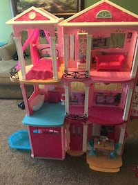 Pink, white, and blue plastic dollhouse Akron, 44305