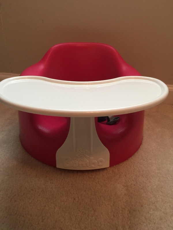 Baby's red and white bumbo seat
