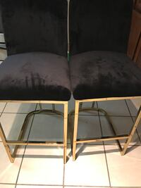 Two black golden framed modern padded chairs, the chairs are brand new never been used. Chairs can be used as dinning set/ high barstool, accent chairs. Lanham, 20706