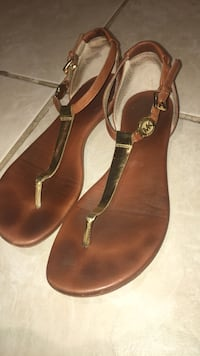 pair of brown leather sandals Ottawa, K1N 6W1
