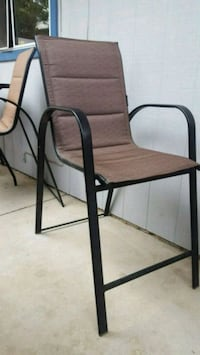 two black metal framed brown padded chairs 1923 mi