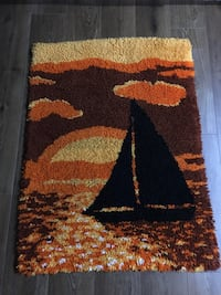 Handmade Area Rug of a sailboat sunset