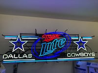 Blue and white neon light sign   Weslaco, 78599