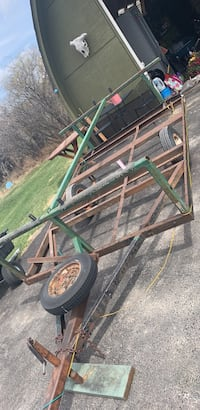 green and brown metal utility trailer
