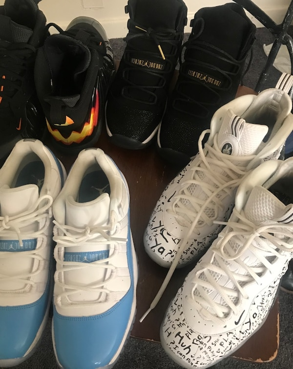 four assorted pairs of basketball shoes