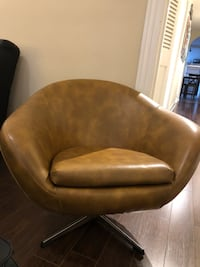 Brown leather padded accent chair rotating  Toronto, M5R 3G8