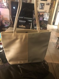 New tote 16x22x4 white and lite blue . Located off lake mead and jone