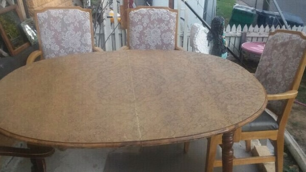 Leather lace oval dinning table and chairs