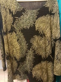 Size Large,  gold and black 3/4 length sleeve. Cape Coral, 33990