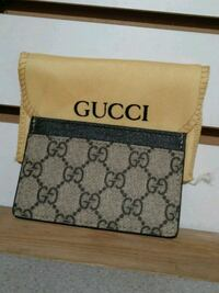 brown and black Gucci wallet Queens, 11373