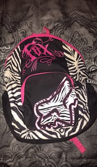 black, white, and pink Fox backpack
