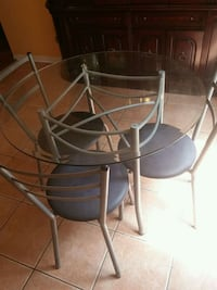 round glass top table with four chairs Mississauga, L5V