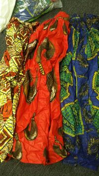 three assorted colored dresses