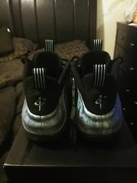 pair of black-and-gray Nike Foamposite Newport News
