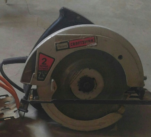 gray and green Sears Craftsman circular saw c022e882-3445-4f85-ae14-c2d9a529a035