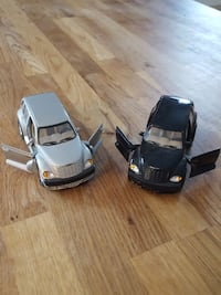 two black and silver Chrysler PT Cruiser scale models