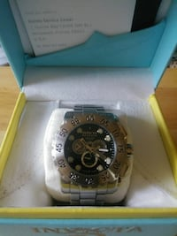 round black Invicta chronograph watch with silver
