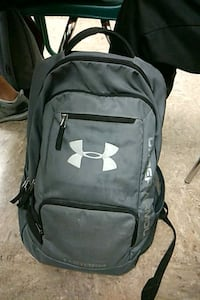 black and gray Under Armour backpack 1964 km