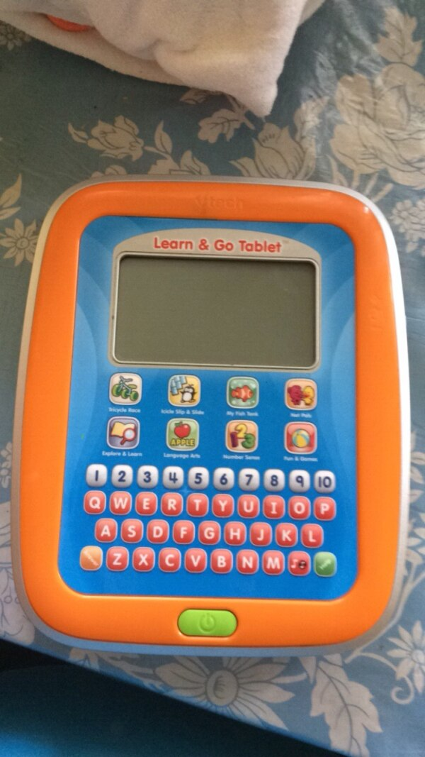 Blue and yellow vtech learning tablet