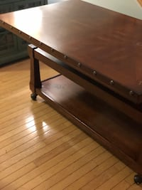 brown wooden framed glass top coffee table Bristow, 20136