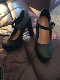 Pair of black leather ankle strap heeled shoes Blackfalds, T4M 0G4