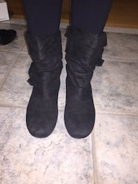 pair of black suede slouchy flat boots