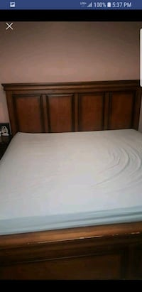 brown wooden bed frame and white mattress Mississauga, L4Z 4H3