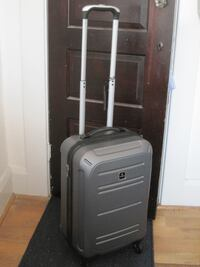"""Tag 20"""" Rolling Suitcase Baltimore"""