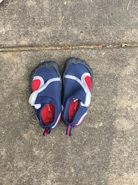 pair of blue-and-orange Nike sandals Dumfries