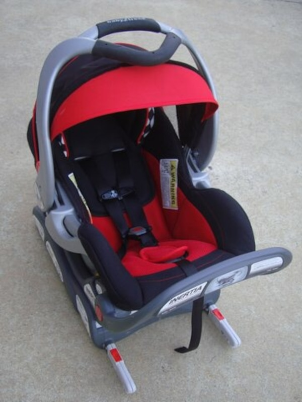 baby's black, gray and red convertible seat