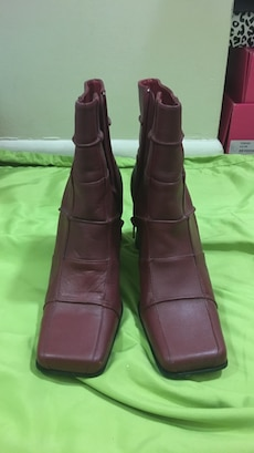 pair of brown leather ankle boots