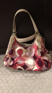 Pink, white, purple, and gray monogram Coach leather hobo bag