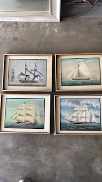 four white ship paintings