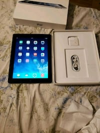 black iPad with box and charger